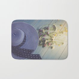 Female hat, striped, bouquet of wildflowers, top view. Bath Mat