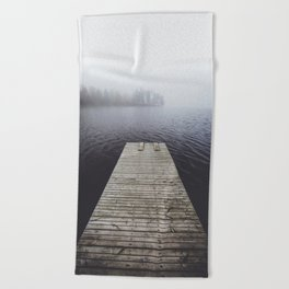 Fading into the mist Beach Towel