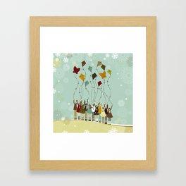 Children flying kites at christmas Framed Art Print