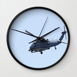 An HH-60G helicopter flies overhead of a rescue boat during a training exercise known as Mode VIII Wall Clock
