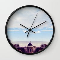 skyline Wall Clocks featuring skyline by Maria Ostapchuk