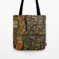 paris map Tote Bags featuring Paris Map by Larsson Stevensem