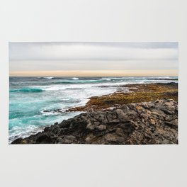 Volcanic Seascape in Fuerteventura at sunset Rug