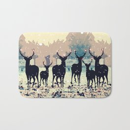 Deer in the snowy forest Bath Mat