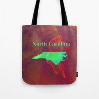 north carolina Tote Bags featuring North Carolina Map by Roger Wedegis