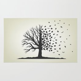 dried tree with branches and flying butterflies Rug