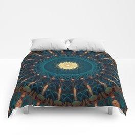 Mandala in blue and golden tones Comforters