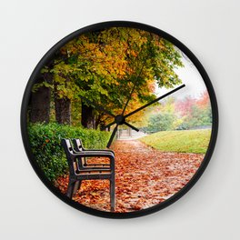 Park bench surrounded by fallen leaves during Autumn Wall Clock