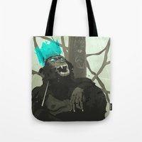 carnage Tote Bags featuring Uneasy Lies the Head That Wears the Holographic Crown by Alex Craig