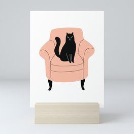 black cat on a chair Mini Art Print