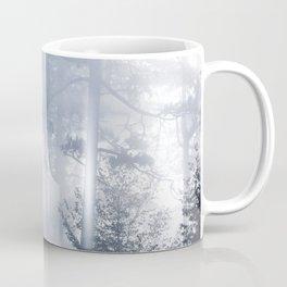 Sun rays shinning through foggy forest Coffee Mug