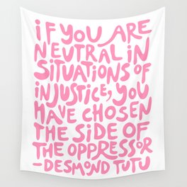 if you are neutral in situations of injustice you have chosen the side of the oppressor (activist quote in groovy pink)  Wall Tapestry