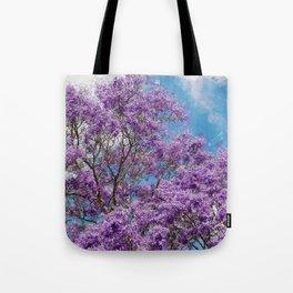 Beautiful Jacaranda Purple floral portrait painting against sea blue sky  Tote Bag