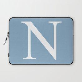 Letter N sign on placid blue background Laptop Sleeve