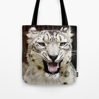 snow leopard Tote Bags featuring Snow Leopard by MehrFarbeimLeben