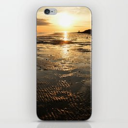 Sunset on the beach at low tide iPhone Skin