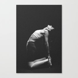 Woman meditating in a yoga pose Canvas Print