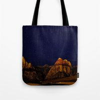 night sky Tote Bags featuring night sky by haroulita