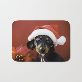 Christmas Dachshund Puppy Wearing a Santa Hat with Poinsettias Bath Mat