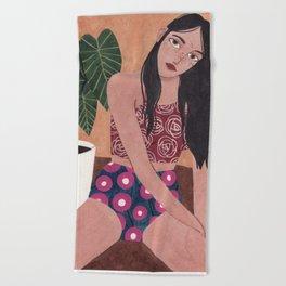 Sitting on the floor Beach Towel