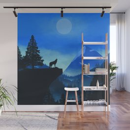 A wolf in the mountain landscape at night Wall Mural