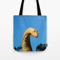 dinosaur Tote Bags featuring Dinosaur by Ink and Paint Studio