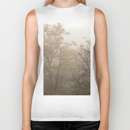 Autumnal naked trees surrounded by fog Biker Tank