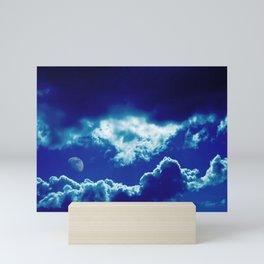 Blue clouds and moon Mini Art Print