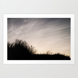 Silhouette in grass and clouds Art Print