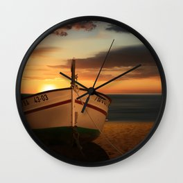 The boat in the sunset Wall Clock