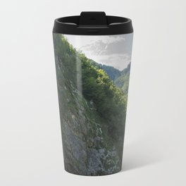 A small waterfall in the mountains Travel Mug