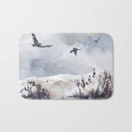Soaring Above Sandy Beaches Against Stormy Skies Bath Mat