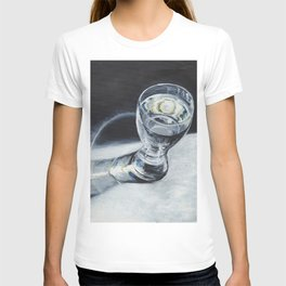 Glass of the water in the light T-shirt