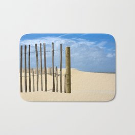 Fence in the sand Bath Mat