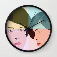 tegan and sara Wall Clocks featuring TEGAN AND SARA  by NURUL A.