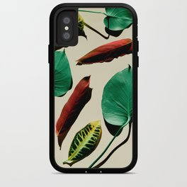 Different leaves laying over a pink background iPhone Case