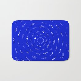 Minimalist Spring Floral Cyclone (White on Blue) Bath Mat