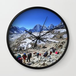 Trekking in Himalaya. Group of hikers  with backpacks   on the trek in Himalayas, trip  to the base  Wall Clock