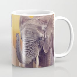 African Elephants walking in the grassland at sunset Coffee Mug