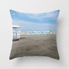 Beautiful black sandy beach and white and blue striped beach houses, Tyrrhenian sea near Roma, Italy Throw Pillow