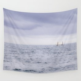 Sailing the ocean blue; two sailboats on the horizon Wall Tapestry