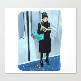 Studying on the Subway Canvas Print