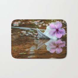 Paperboat in water with periwinkle Bath Mat