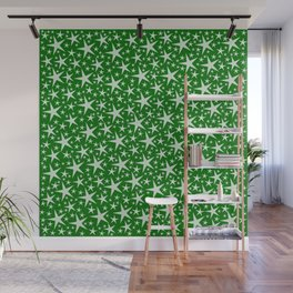 many small stars on festive paper background in green Wall Mural