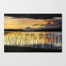 Calm sunset at the lake after the storm Canvas Print