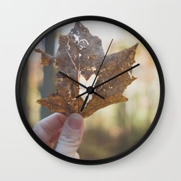 Heart inside dying leaf Wall Clock