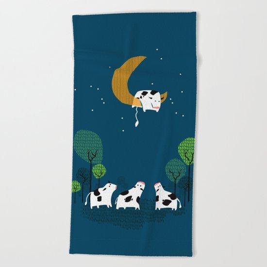 A cow jump over the moon Beach Towel