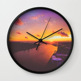 fiery sunset over the Detroit River Wall Clock