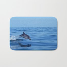 Spotted dolphin jumping in the Atlantic ocean Bath Mat