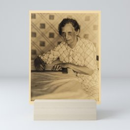 Doris Ulmann  (1882–1934), Elderly woman in glasses and dress, seated at table with pencil and T-squ Mini Art Print